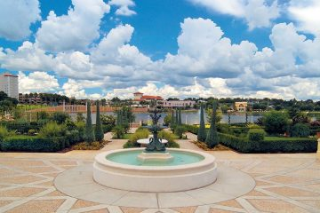 Fountain And Lake Mirror In Florida By Africa One Tours