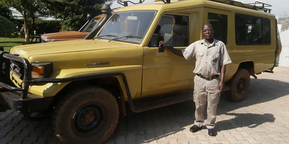 Gorilla Tours Guide with a tour truck