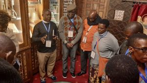 Tourists praying in Israeli church, by Africa One Tours and Travels Ltd